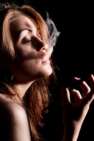 Young Women Smoke Cigarette Holder Stock Photo - 4083997