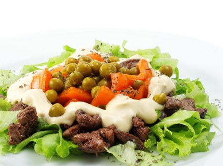 composed: Chicken Salad Composed Chicken Liver and Pepper Dressed with Salad Leaves and Green Peas. Isolated on White Background