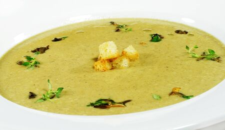 Cream of Mushroom Soup Served with Dried Crust and Green photo