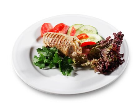 Pork (or Beef) Grilled Roll with Greens and Vegetables on a Plate. Isolated on White Background photo