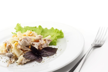 Pineapple Salad with Chicken, Corn and Leaf of Basil. Isolated on White Background photo