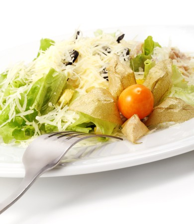 Caesar Salad Comprises Romaine Lettuce and Croutons Dressed with Parmesan cheese. Isolated on White Background photo