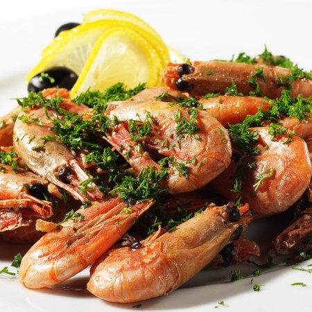 Shrimps Plate Served with Lemon and Olives Stock Photo