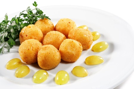 croquettes: Cheese Croquettes Plate Served with Parsley and Sliced Grape. Isolated on White Background
