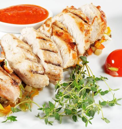 Fillet of Chicken with Vegetables and Cherry Tomato and Spicy Sauce photo