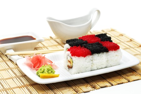 Rolls Chess with Red and Black Caviar. Served with Soy Sauce and Chopsticks on Bamboo Napkin photo