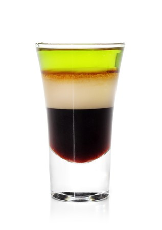 Layered Cocktail Shooter made of Absinthe, Irish Cream, Kahlua. Isolated on White Background photo