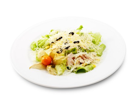 romaine: Caesar Salad Comprises Romaine Lettuce and Croutons Dressed with Parmesan cheese. Isolated on White Background
