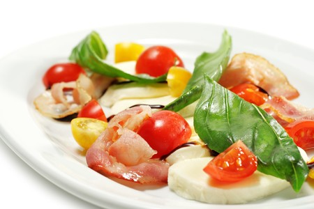 Salad with Cherry Tomato, Buffalo Cheese, Bacon and Vegetable Leaf. Isolated on White Background photo