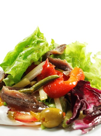 Salad with Anchovy, Olive and Vegetable Leaf. Isolated on White Background photo