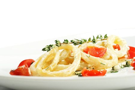 Salad with Calamari Rings, Sheep Cheese and Tomato. Isolated on White Background photo