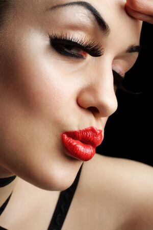 Girl with Red Lips over Black Background photo