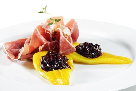 Ham with Pear and Berries Isolated over White photo