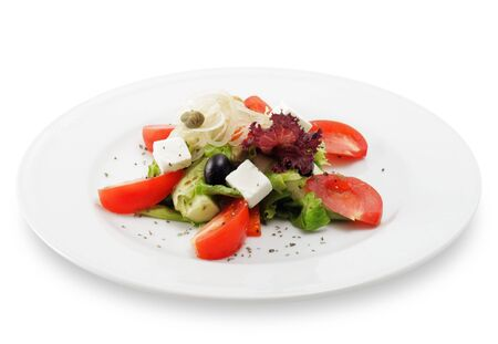 Greek Salad Plate with Tomato, Cucumber, Onion and Olives. Isolated on White Background photo