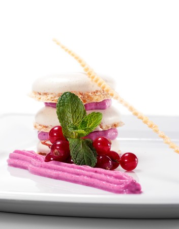 Meringue Cake with Blackberries Mousse and Fresh Mint Leaf and Fresh Berries. Isolated on White Background photo