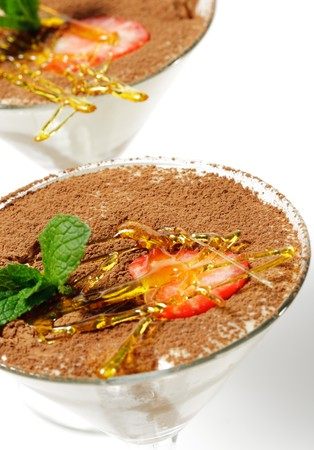Tiramisu Dessert in a Glass with Mint and Strawberry. Isolated on White Background photo