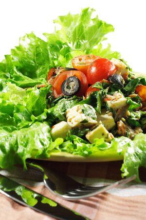 Healthy Vegetable Salad Served on Fresh Salad Leaves  photo