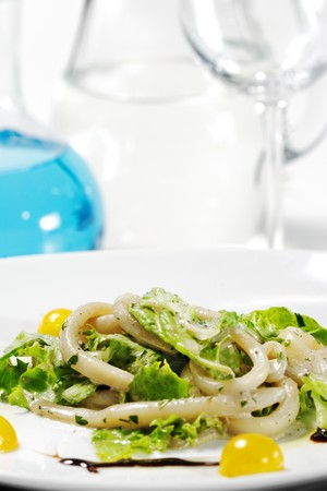 Seafood Salad with a Jug on a Background photo
