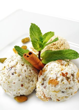 caramel sauce: Dessert - Home-made Ice-cream with Fresh Mint and Cinnamon. Isolated on White Background