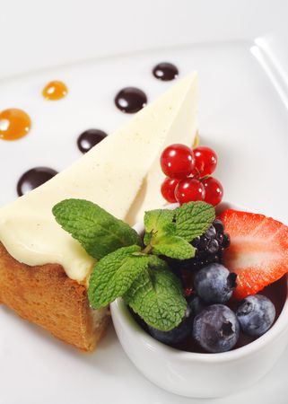 Dessert - Cheesecake with Fresh Berries Bowl and Green Mint photo