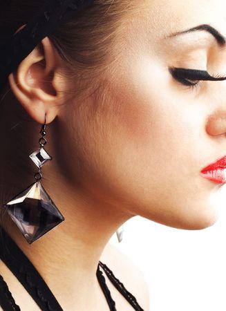 Beauty Model with Earring and False Eyelashes photo