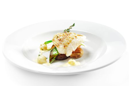 halibut: Hot Fish Dishes - Halibut fillet with Mushrooms, Tomatoes and Bacon Stock Photo