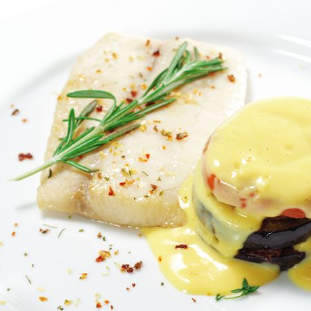 Hot Fish Dishes - Sole with Zucchini, Bell Peppers and Tomatoes Stock Photo