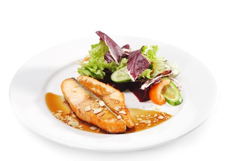 Hot Fish Dishes - Salmon Steak with Narsharab Sauce and Fresh Salad Leaves photo