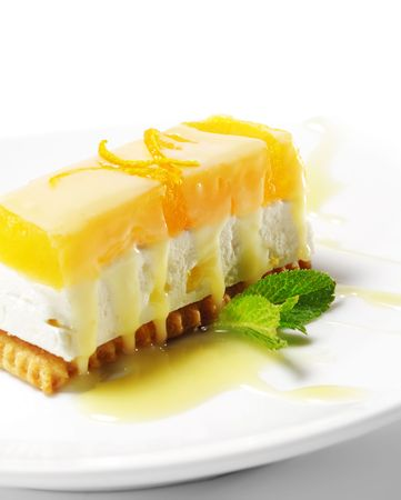 dessert plate: Dessert - Orange Cheesecake with Fresh Mint Stock Photo