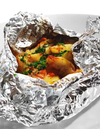 Baked Fillet of Fish in Foil with Vegetables photo