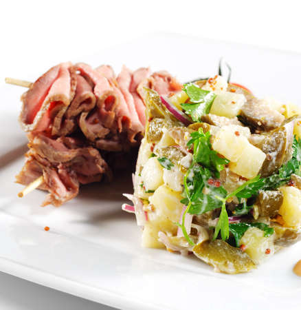 Roast Beef Served with Salad (Potatoes and Vegetables) and Cherry Tomato photo