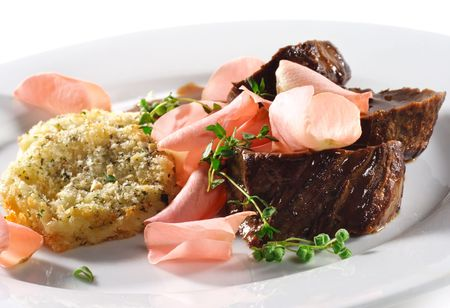 Beef Plate with Potatoes Galette Served with Boiled Rose Petal and Wine Sauce Stock Photo - 4958257