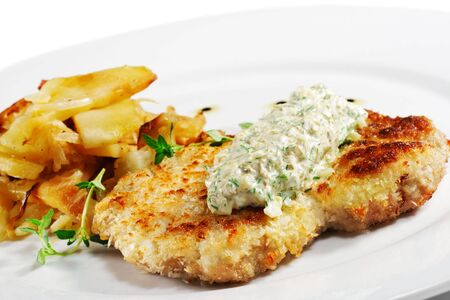 tartar: Pork Schnitzel with Fried Potato and Sauce Tartar