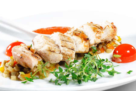 Fillet of Chicken with Vegetables and Cherry Tomato and Spicy Sauce Stock Photo - 4958299