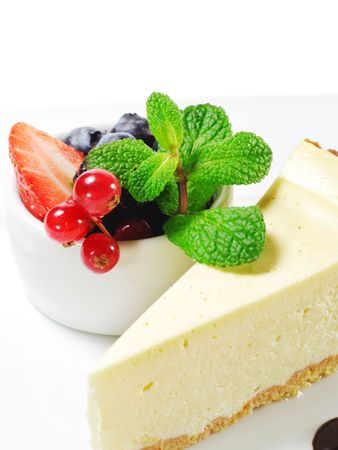 Dessert - Cheesecake with Fresh Berries Bowl and Green Mint