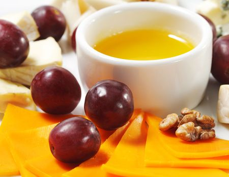 Dessert - Cheese Plate with Grapes and Sweet Sauce photo