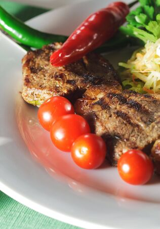 Hot Meat Dish - Grilled Meat with Vegetables Salad photo