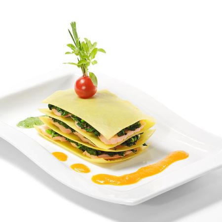 Salmon Lasagna with Spinach, Cherry Tomato and Herbs Stock Photo