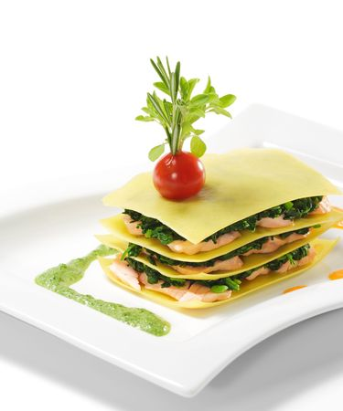 lasagna: Salmon Lasagna with Spinach, Cherry Tomato and Herbs Stock Photo