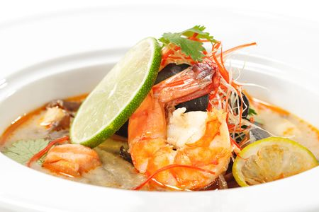 tom: Thai Dishes - Tom Yam Kung. Spicy Shrimp Soup with Coconut milk, Lime and Seafood