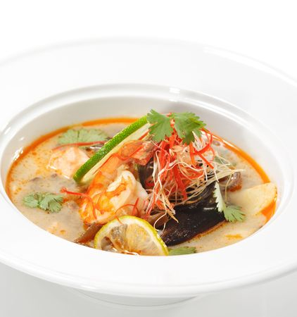 meat soup: Thai Dishes - Tom Yam Kung. Spicy Shrimp Soup with Coconut milk, Lime and Seafood