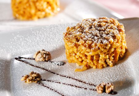 dainty: Chak-Chak is a Tatar Dainty made from Pastry Grains and Nuts Stock Photo