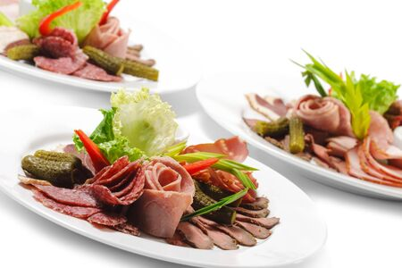 Cold Meat Dish - Sliced Meat Plate  with Fresh Salad Leaf and Pickled Vegetables photo