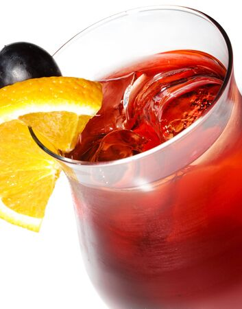 Red Alcoholic Cocktail with Orange Slice and Grape photo
