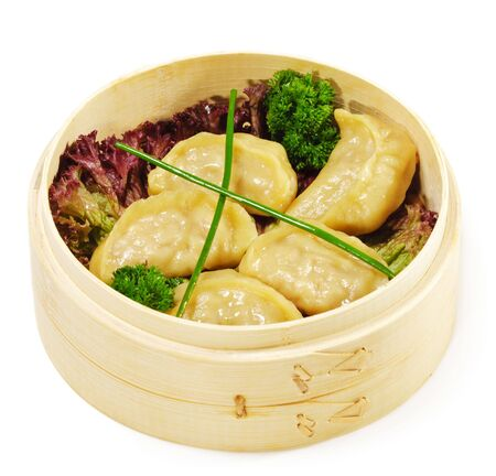 bast basket: Japanese Cuisine - Pork Dumplings in Bast Basket with Salad Leaf