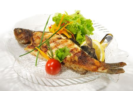 Fish Dishes - Grilled Trout with Salad Leaves and Cherry Tomato photo
