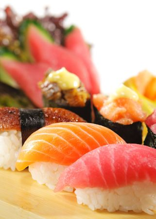sushi plate: Japanese Cuisine - Sushi Set: Salmon, Conger and Tuna Sishi with Salad Leaf