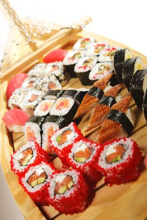 japanese Cuisine - Wooden Ship with Various Type of Sushi photo