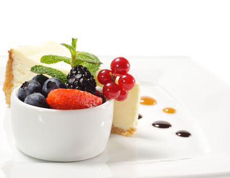 Dessert - Cheesecake with Fresh Berries Bowl and Green Mint Stock Photo - 5472058