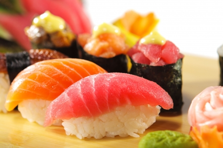 nigiri: Japanese Cuisine - Sushi Set: Salmon, Conger and Tuna Sushi with Salad Leaf Stock Photo